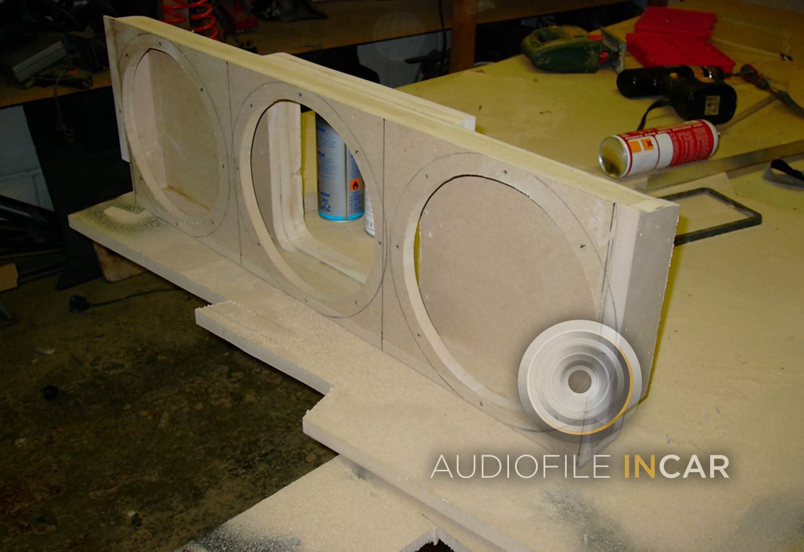 "slightly more extreme installation, here we create a ""vent baffle"" rather than an enclosure, this allowed the output of 3 x 10"" subwoofers to be pumped through the ski hatch, this was an amazing system with the amp in a custom panel in the boot floor."