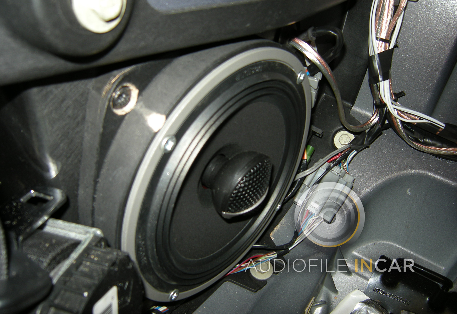 "This shows the Audison Voce 6.5"" Coaxial speaker fitted in a solid MDF baffle in the rear quarter of the Jaguar XK."