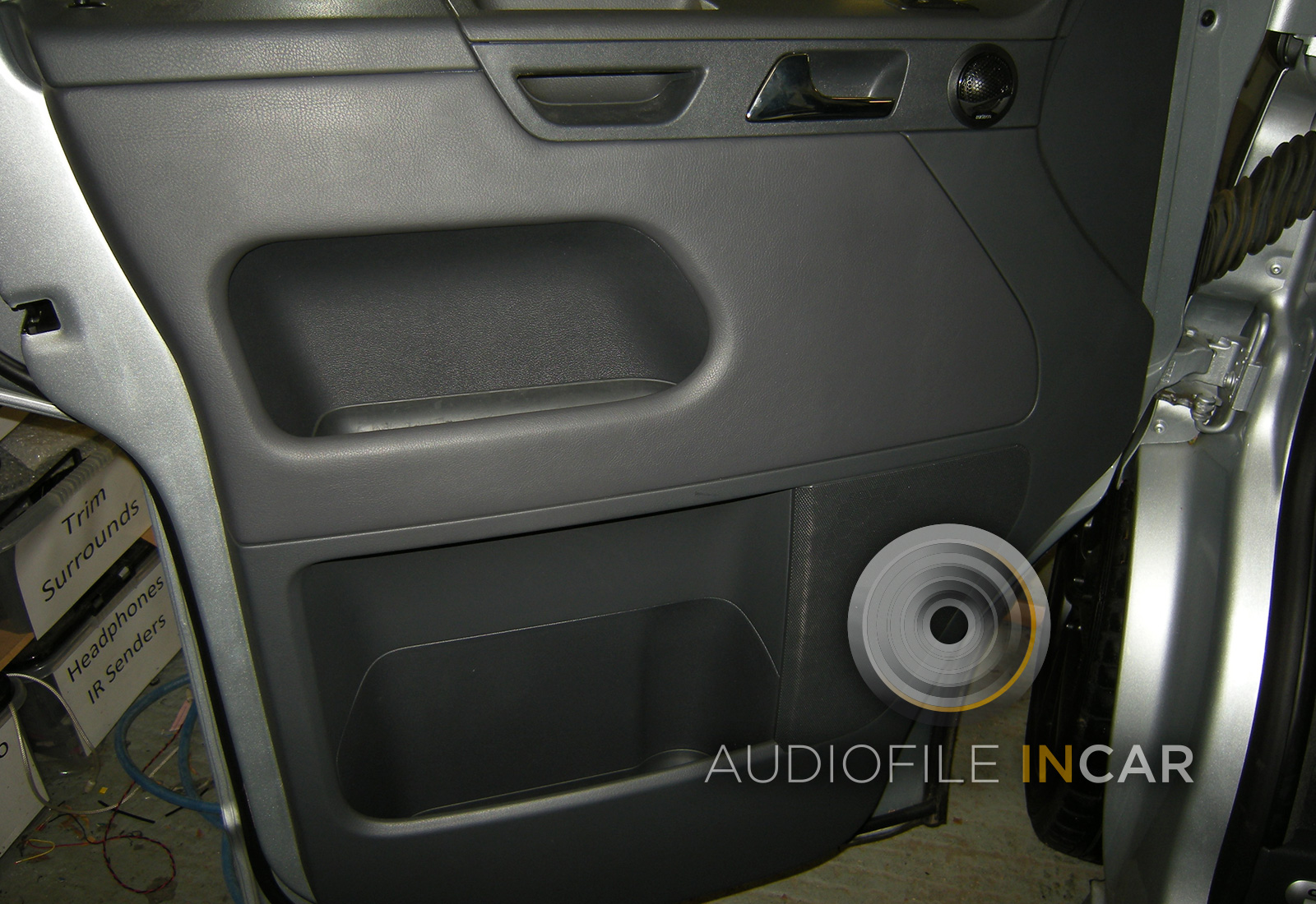 This image shows the Audison tweeter flush fitted into the re-assembled door which is now completely sound proofed.