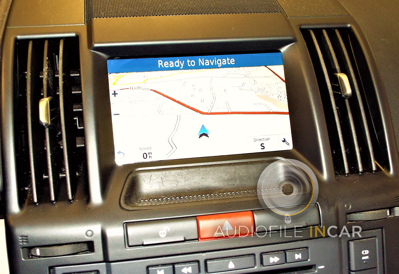 "Above: Snooper 7"" touch screen Navigation fitted in factory location."
